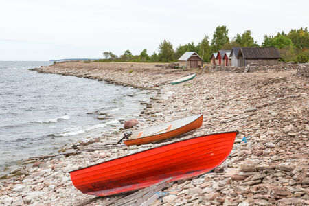 Boats drawn up on the beach photo