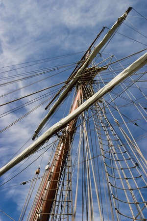 tall ship: Old wooden mast at a tall ship Stock Photo