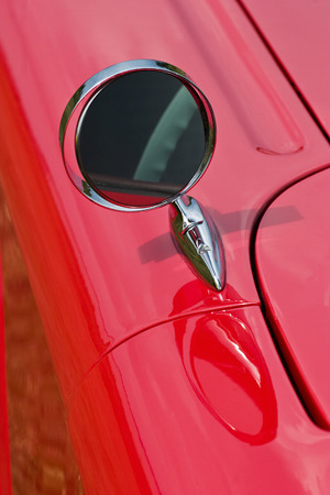 Driving mirror on a american car photo