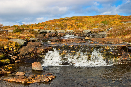 heathland: Waterfall in autumn colored landscape Stock Photo