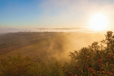 Morning mist in countryside landscape photo
