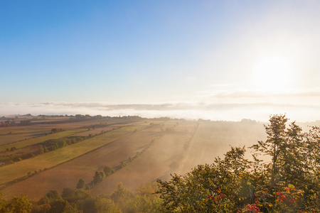 View of rural landscape in misty morning light photo