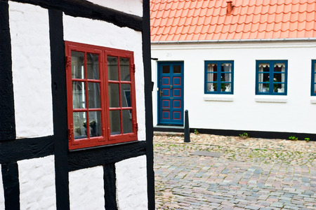 half  timbered: Old half timbered house an a cobblestone street