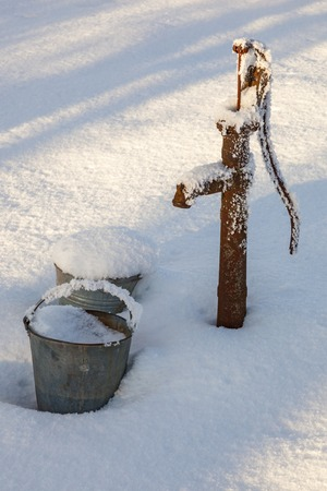 Water pump in the garden at winter 版權商用圖片