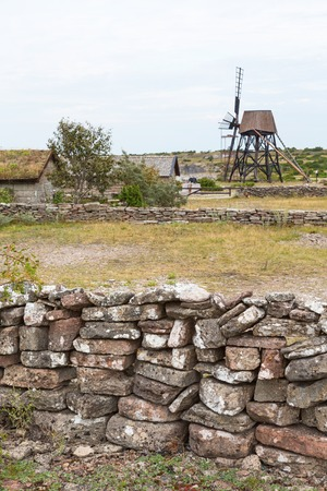 oland: Stone walls with a windmill in the background