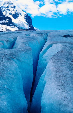 Glacier crevasse and a mountain peak in the background