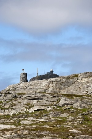 navigation aid: Seamark and a radar station on acliff Stock Photo