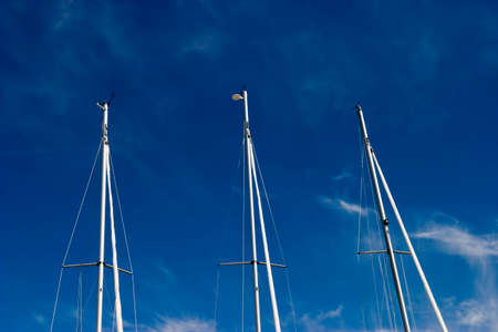 mast: Pleasure boats mast and a blue sky Stock Photo