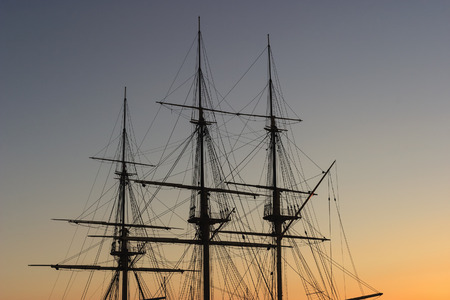 mast: Tall ship mast in sunset Stock Photo