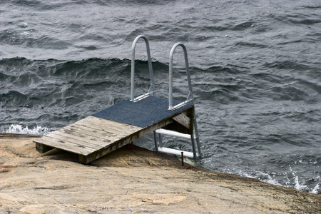 a bathing place: Diving board at the sea