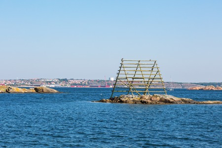 nautical structure: Old drying rack for fish at sea Stock Photo