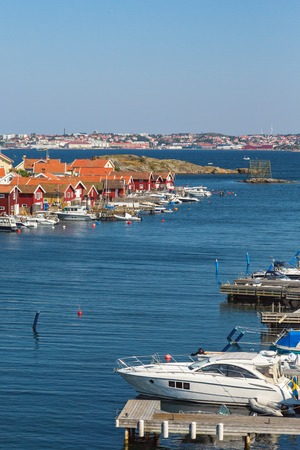 nautical structure: Marina in Fiskebackskil an old fishing village with Lysekil city in the background on the Swedish west coast Stock Photo