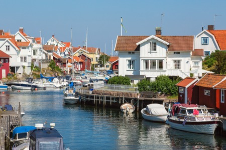nautical structure: Houses and boats at the canal in an old fishing village