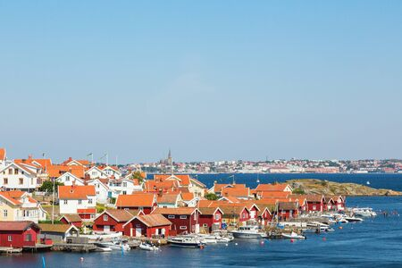 fishing village: Fiskebackskil an old fishing village on the Swedish west coast, with Lysekil city in the background