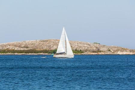 rocky coastline: Sailboats at the rocky coastline at summer Stock Photo