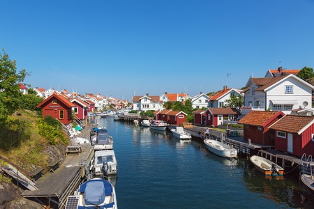 sailingboat: View of the canal with boats and houses on the Swedish west coast