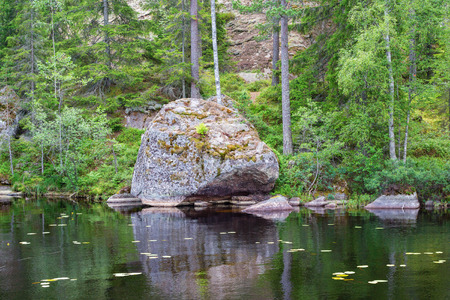 erratic: Erratic boulders located on a beach in the lake Stock Photo