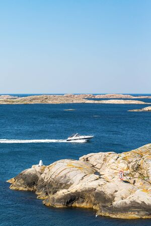 motorboat: Motorboat in the rocky archipelago Stock Photo
