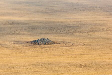 cairn: Stone cairn on a stubble field Stock Photo