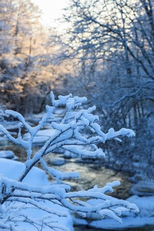 frosty: River running through the winter landscape Stock Photo