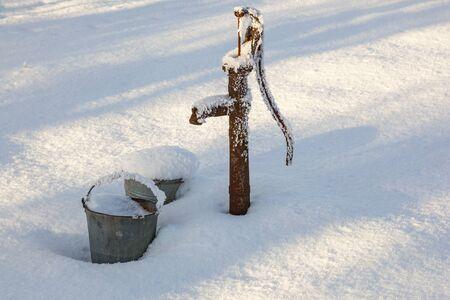 bomba de agua: Water pump in the garden with snow Foto de archivo