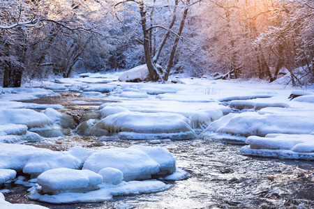 the trees covered with snow: Winter landscape by a river in the sunset Stock Photo