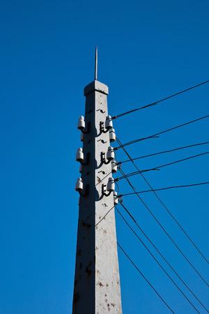 telephone pole with porcelain insulators