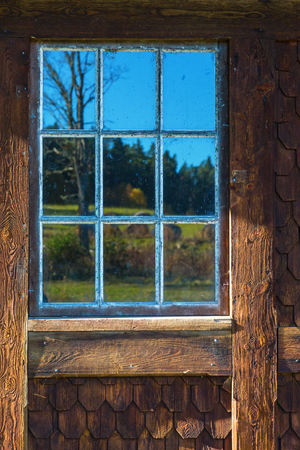 casement: Old casement windows on a wooden cottage