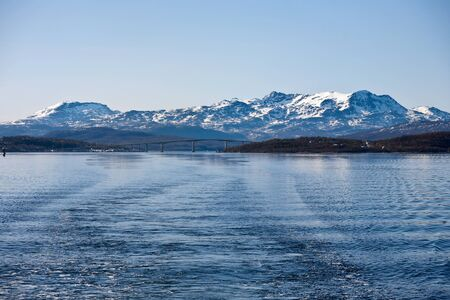waterscapes: Norwegian coast landscape with snow on the mountain Stock Photo
