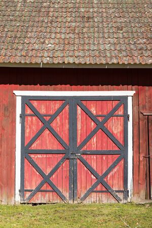 red door: Old doors of a barn