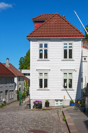 residential idyll: Street with old wooden houses in Bergen, Norway