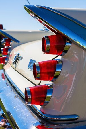 stoplights: Wing with tail lights on a classic American car