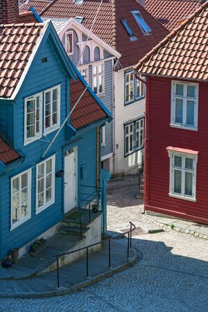 urban idyll: Street alley with wooden houses in Bergen, Norway Stock Photo