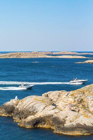 motor boat: Motor boat in rocky sea coast