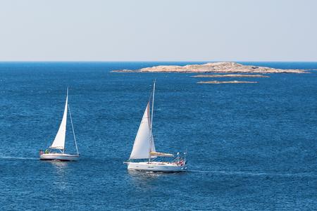 sailing boats: Sea view over the coast with sailing boats