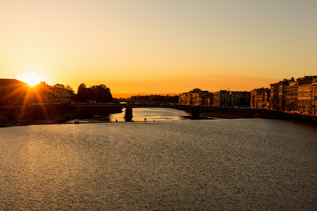 arno: Sunset with sunbeams over the River Arno in Florence