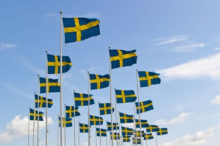 flagpoles: Swedish flag sway in the breeze