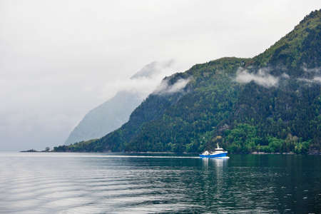 waterscapes: Fishing boat in fjord landscape