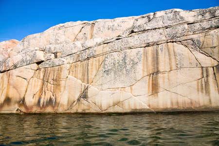 waters: Granite rocks at the waters edge Stock Photo