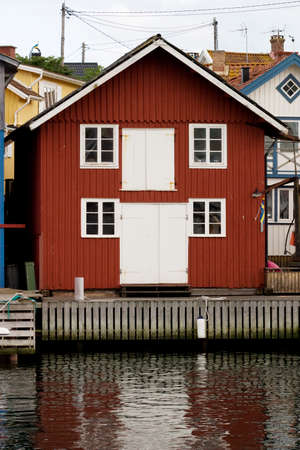 Red wooden boat house at the water Stock Photo
