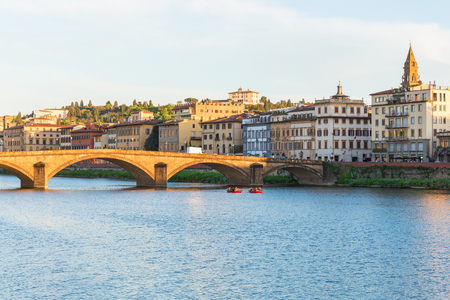 Boats on the River Arno in Florence Stock Photo