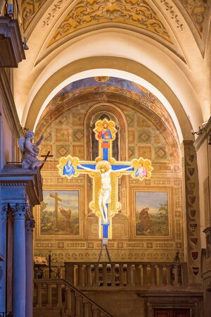 Crucifix with Jesus in Chiesa di Ognissanti church in Florence, Italy