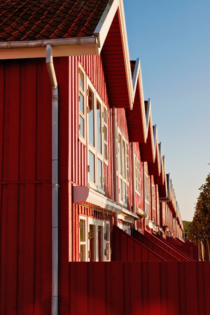 terrace house: Red terrace house in evening light
