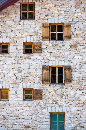osttirol: Old stone house with window shutters