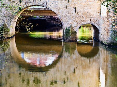 Old stone bridge and a river