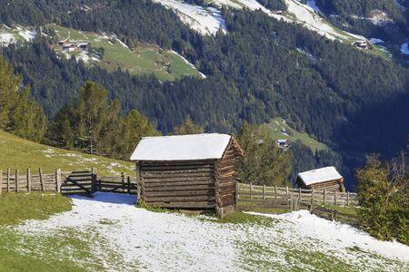 osttirol: Wood shacks on the field in alp landscapes