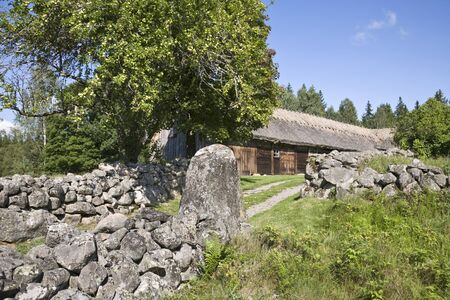 old farm: Old farm with stone walls around the field