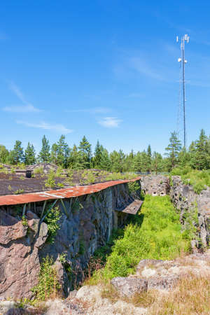rockwall: Fortress that is blasted into the rock, Vaberget, Karlsborg in Sweden. with a phone mast Stock Photo