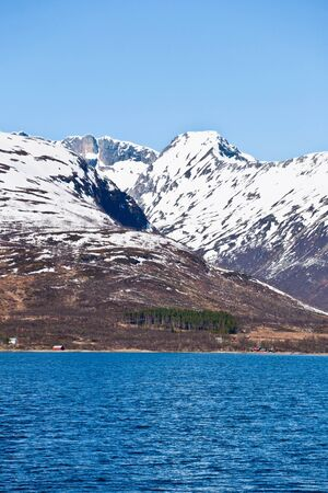 snow capped: Rocky coast and snow capped peaks