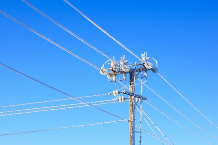 hoarfrost: Electrical power pole with hoarfrost Stock Photo